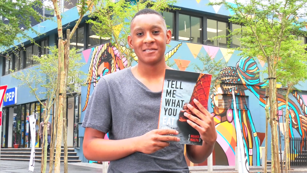 Muako Maepa with his book, Tell Me What You Eat, in Jewel City.