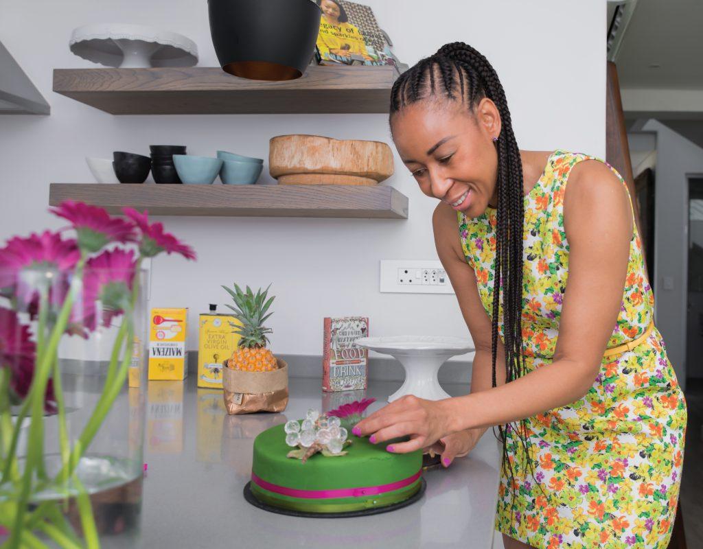 Khanyisa Malabi adding the final decorative touches to a cake.